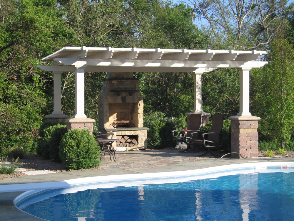 Tan Vinyl Pergola With Stone Fireplace And 7 Square